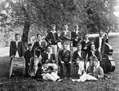 Music hath charms... (National Library of Ireland on The Commons) Tags: ahpoole arthurhenripoole poolecollection glassnegative nationallibraryofireland musicclass rockwellcollege cotipperary fatheregan rockwell countytipperary music musicians egan cashel newinn school instruments drum cello bass violin schoolgroup