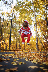 The real way to jump in leaves (Elizabeth Sallee Bauer) Tags: active autumn beautyinnature boy child childhood fall fun jumping kid leaves outdoors outside playing trampoline trees youth