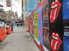 Iron Maiden with Rolling Stones Lips and Tongue Posters 5238 (Brechtbug) Tags: iron maiden concert poster blue construction fence eddie devil monster zombie album british heavy metal skeletal sidekick west 45th street nyc 2018 november 11182018 brit soldier creepy demon dude union jack flag torn billboard posters billboards cover art with rolling stones lips tongue