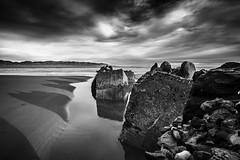 "tumbled sea defences under a lowering sky, fine art black & white, Newburgh beach, Aberdeenshire, Scotland (grumpybaldprof) Tags: bw blackwhite ""blackwhite"" ""blackandwhite"" noireetblanc monochrome ""fineart"" striking artistic interpretation impressionist stylistic style contrast shadow bright dark black white illuminated canon 7d ""canon7d"" sigma 1020 1020mm f456 ""sigma1020mmf456dchsm"" ""wideangle"" ultrawide seadefences drama dramatic sky clouds sand estuary ythan"