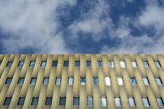 Windows and clouds (Jan van der Wolf) Tags: map170201v clouds wolken parkinggarage parkeergarage gold windows ramen facade gevel utrecht architecture architectuur reflection spiegeling