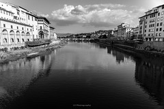 Theirs was the laughter in the winding stream, and in between (.KiLTRo.) Tags: firenze toscana italy it kiltro florence italia river arno stream reflection sky clouds city bridge street life nikon d750 europe cityscape bw blackandwhite