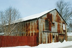 Barn in Clinton, Wisconsin (Cragin Spring) Tags: wisconsin wi midwest unitedstates usa unitedstatesofamerica rural snow winter rust metal fence rusty barn clinton clintonwi clintonwisconsin