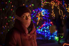 The Woman in the Red Coat (noname_clark) Tags: night dark light christmas gardensonspringcreek katherine bokeh heart