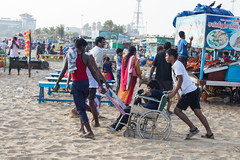 Down by the Sea, Chennai (Geraint Rowland Photography) Tags: touching touchingmoment streetphotography travelphotography documentaryphotography photo canon canonfullframe canonindia wheelchair wheelchairusers wheelcharirsonthebeach wheelchairbound disabled physicallyhandicapped camaraderie fun boys unity friendship sand push