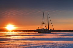 frozen (twurdemann) Tags: bellevuepark cold dawn frozen fujixt1 horizon ice ontario sailboat saultstemarie seascape seasmoke silhouette sky snow stmarysriver sugarisland sunrise winter xf55200mm
