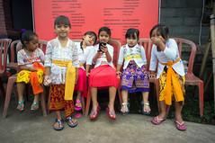 kids (kuuan) Tags: manualfocus mf voigtländer15mm cvf4515mm 15mm bali indonesia sonynex5n festival temple kids girls traditionaldress kebaya