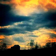 Barn silhouetted against a dramatic sunset. (kegrose) Tags: sunset stormclouds stormy dusk goldenhour barn trees silhouette orange red skyporn
