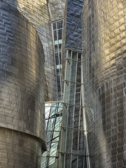 Guggenheim Museum 3 (RobertLx) Tags: architecture guggenheim museum guggenheimmuseum bilbao bilbo deconstructivism spain europe bizkaia city building icon contemporary modern gehry frankgehry steel aluminium glass basquecountry guggenheimbilbaomuseum vertical
