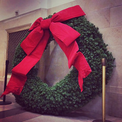 Giant wreath, slouched against the wall waiting to be hung. (spudart) Tags: 121nlasallest 60602 chicago chicagocityhall christmaswreath cityhall dec december hdr highdynamicrange highdynamicrangephotography illinois lasallestreet prohdrapp usa cameraphone christmas downtown government iphone loop winter xmas