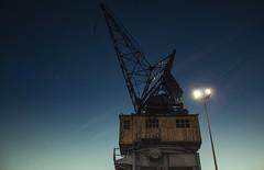 Crane (Markspitz15) Tags: canon 70d 1855mm high iso dark night malaga harbor port harbour lights light backlight noria wheel machinery museo museum blue sky lamppost farola streetlight