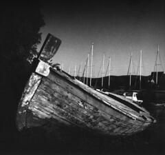 Waiting for new escapades (lumpy79) Tags: escapade arax60 czj flektogon 450 ilford pan f plus 50 f11 1125 ark boat blackandwhite bw hvar croatia vrboska