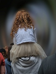 Moving Toward The Future (Scott 97006) Tags: travel time people girl kid redhead shoulders carried direction future back behind crowd