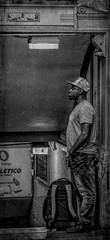 Waiting in the rain...... (Kevin Povenz Thanks for all the views and comments) Tags: 2018 july kevinpovenz chicago illinios streetphotography street windycity man male blackandwhite bw canon7dmarkii sigma24105art waiting smoking hat rough