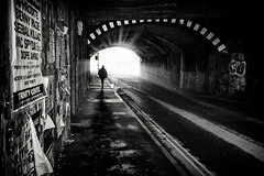 underpass (Daz Smith) Tags: dazsmith fujifilmxt3 xt3 fuji bath city streetphotography people candid portrait citylife thecity urban streets uk monochrome blancoynegro blackandwhite mono bristol man walking silhouette posters underpass tunnel