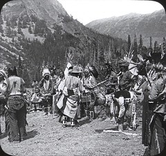 """Blackfeet Indians Preparing for Medicine Lodge Ceremony, Glacier National Park, Mont."" (ca. 1920s). Lantern Slide Image 188 (22000), Keystone View Company. (lhboudreau) Tags: nativeamericans lanternslide lanternslides nativeamerican americanindian vintagephoto vintagephotograph vintagephotography monochrome blackandwhite blackwhite 1920 1920s image keystone keystoneview keystoneviewcompany slide188 22000 outdoor outdoors indian photo antiquephoto mountain mountains people indians americanindians landscape slide glaciernationalpark montana sky blackfeetindians medicinelodge ceremony medicinelodgeceremony blackfeet trees mountainside"