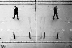 (halagabor) Tags: bnw blackandwhite monochrome mirror reflection glass symmetry reflex street streetphoto streetphotography urban city citylife film filmisnotdead filmcamera filmisalive filmphotography ishotfilm ishootfilm 35mm analog analogcamera nikon nikkor nikonfe2 ilford hp5 push 1600 grain grainy budapest hungary