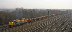 In 'Dutch' livery 37211 proceeds south of Doncaster with a down train of EWS civil engineer's wagons. (mikul44171) Tags: 37211 belmont doncaster rudd seacows wagons junction