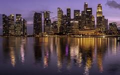 Singapore Skyline (Jack Heald) Tags: singapore city cityscape buildings night lights reflections bay water panoramic heald jack nikon d750 zeiss 21mm bluehour skyline sunset