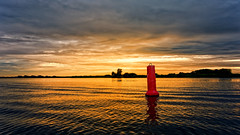 Red With Shit On The Head (Alfred Grupstra) Tags: sunset nature reflection water dusk sky sea lake sun summer outdoors silhouette sunlight orangecolor landscape sunrisedawn yellow cloudsky red beautyinnature 90