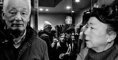 Sales confusion!! (Baz 120) Tags: candid candidstreet candidportrait city contrast street streetphotography streetphoto streetcandid streetportrait strangers rome roma ricohgrii europe women monochrome monotone mono noiretblanc bw blackandwhite urban life portrait people italy italia grittystreetphotography flashstreetphotography faces decisivemoment