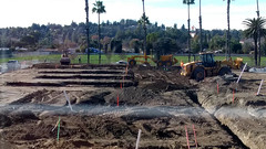 (Rich T. Par) Tags: pomona phillipsranch socal southerncalifornia losangelescounty lacounty constructionsite constructionvehicles california palmtrees tree suburb tractor dirt civilengineering grader sky frontloader steamroller roadroller civilengineers heavyequipment trench ladder