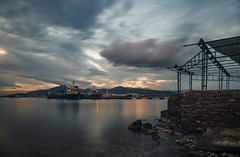 Industrial Sunset (panos_adgr) Tags: nikon d850 long exposure photography sunset winter sea water sky clouds blue light motion rocks stones reflection nd filter elefsis elefsina attica travel greece