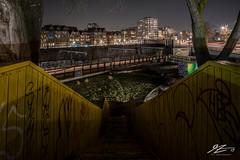 Negative Zone (TVZ Photography) Tags: luchtsingel stairs park railway rail lighttrail train cityscape city rotterdam netherlands holland night evening longexposure lowlight sonya7riii zeiss loxia 21mm