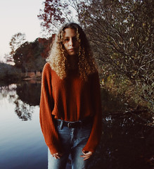 A Cold Orange Serious Model (skye-skye) Tags: girl girls teen teenager teenagers teens women woman man men boy boys model portrait modeled young youth child children highschool nature tree trees lake water outdoor outdoors teenmodel youngphotographer orange fall winter cold vsco edit edited curly curlyhair beautiful amazing cool weird unique