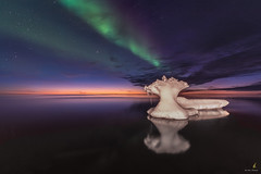Northern Lights, Sunset and Iceberg (Chriskellyphotography) Tags: abovethearcticcircle aurora auroraborealis arcticocean coast clouds northwestterritories nature nikkor20mm northernlights nightsky skies sea sunset tuktoyaktuk landscape water reflection iceberg ice ocean winter