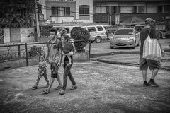 Walk in the Park (Beegee49) Tags: street blackandwhite monochrome filipina bw family man woman children walking sony a6000 happy planet bacolod philippines city asia