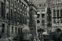 nothing stays (claudia 222) Tags: amsterdam dam longexposure noctilux rain architecture bw 50mm magna plaza palace street monument 30sec f16 day ghost selfie dedam