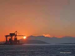 Hunterston Crane Sunset (g crawford) Tags: ayrshire northayrshire crawford clyde firthofclyde water sea orange yellocranes crane sunset sundown sun sky hunterston fairlie cumbrae weecumbrae arran oreterminal