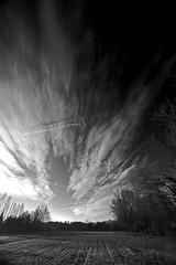 Urban monochrome sky in 3D (Robyn Hooz) Tags: nuvole clouds padova town hometown aereo trail black white monochrome mood pensiero grigio cielo sky