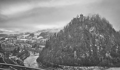 East Tower poking through the low Clouds (Eadbhaird) Tags: austria aut hohenwerfencastle mist clouds bw river whereeaglesdare festunghohenwerfen pine tree snow