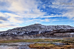 Sulfuric Lands (World_Of_Photos) Tags: iceland winter landscape mountains sulfur river grass snow blue sky photography geysir steam earth