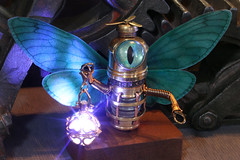 Fairy Robot with glowing lantern (Catherinette Rings Steampunk) Tags: fantasy adoptables dungeons dnd sculpture modron handmade etsy metal art artisan wirewrapped figurine creatures weird oneeyed cyclopean brass copper canadian glowing cute