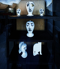 Face Time (Steve Taylor (Photography)) Tags: vase urn tears cat shelving eyepatch face art shop store black blue brown white woman lady newzealand nz southisland canterbury christchurch cbd city contrast