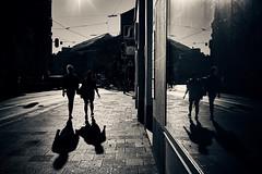 Double trouble - or: Eight silhouettes (iamunclefester) Tags: münchen munich street autumnstreetphotos autumn blackandwhite monochrome toned silhouette double trouble eight two backlight shopwindow shop window windowpane castshadow hardshadow trafficsign tram tramway tracks reflection autumnbacklightseries lowsun