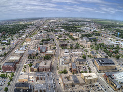 Fargo is a the largest City in North Dakota on the Red River (JacobBoomsma) Tags: fargo cityscape tower river road architecture town outdoor exterior outside brown fence north cloud station blue train dakota clouds downtown tourism nature snow urban car scene trafficlight view winter spring storm street sky cold northdakota skyline aerial drone above summer