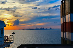 Chi-town Sunset on Lake Michigan (knutsonrick) Tags: chicago skyline clouds sunset greatlakes lakemichigan asc americansteamshipcompany mvindianaharbor footer 1000footer indianaharbor taconite arcelormittal steelmill