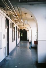 Half past three (tripl8_i) Tags: tokyo tukiji 東京 築地市場 yashica electo35mc yashinondx 40mm28 clock curved corridor