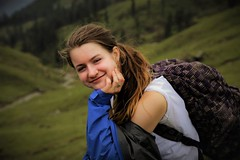 Gina On The Trail (Scott RS) Tags: portrait grass tree green trekking hiking daypack rainshell shoulder ear smile smirk eyes hair skin smooth delicate beauty gorgeous engaging pretty kind fun funny witty earring ring trail tender effusive real playful fingers bareshoulder canon canon6d canon24105 canonphotography travel friend confident connected sweet beautiful traveler india meadow mountains loving knowing magnetic arm rest sit