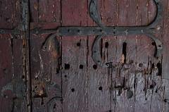 All Was Locked And Barred (MPnormaleye) Tags: door grain texture ancient medieval castle ironworks rust metal lock hinge utata 24mm