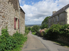 Bretagne/Brittany, Locronan. A view of the valley. (Traveling with Simone) Tags: locronan bretagne brittany renaissance town village vue view landscape houses france stones clouds nuages hydrangeas trees arbres fliksb flickrsbest friends