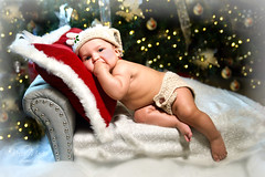 Winter Wonderland Aliyah (glasskunstler) Tags: baby child girl portrait christmas reindeer pillows bed trees decorations chaise fur holly hat ribbons ornaments