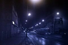 Night Trip, 2018-11-18 (Other dreams) Tags: kodak p3200 nighttrip night city nocturnal cityscape analogue olympustrip35 trip35 dzuiko d76 poland myplace autumn drizzle rain fall wet street trammy rails pavement sidewalk streetlights commuters