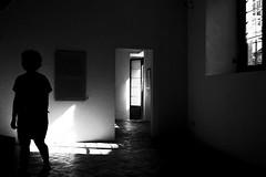 C h i l d   i n  T i m e (Gaia Rampon) Tags: menomalechec'ero wistfulness impermanence pathos inpraiseofshadows bnw bw 35mm nikkor interior doors windows timeless childintime colorless colorblind shadow light mystery noir blancetnoir noiretblanc white black blackandwhite transitorietà trascendenza solitude wabisabi