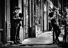 Choices (Kieron Ellis) Tags: man men standing phone sunny pavement wall bike people suit casual shadow contrast sunglasses headphones door candid street blackandwhite blackwhite monochrome