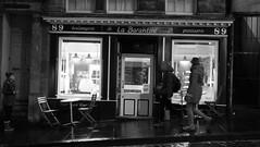 La Barantine (byronv2) Tags: dusk night nuit nacht edinburgh edinburghbynight scotland oldtown architecture building peoplewatching street candid blackandwhite blackwhite bw monochrome labarantine boulengerie patisserie shop window slope bakery cafe french francais victoriastreet winter weather rain wet